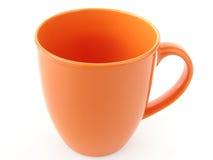 Taza anaranjada Fotos de archivo