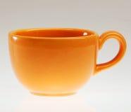 Taza anaranjada Fotografía de archivo libre de regalías