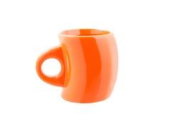 Taza anaranjada curvada Fotos de archivo libres de regalías