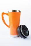 Taza anaranjada de aluminio foto de archivo libre de regalías