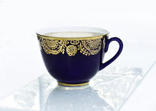 Taza azul de té Fotografía de archivo