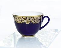 Taza azul de té Fotos de archivo libres de regalías