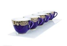 Taza azul de té por la mañana Imagenes de archivo