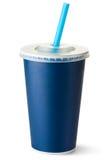 Taza azul marino de la cartulina con una paja Imagen de archivo