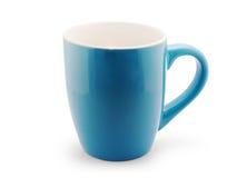 Taza azul vacía del coffe en blanco Imagen de archivo libre de regalías