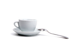 Taza blanca de té en un fondo blanco Imagen de archivo