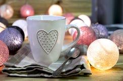 Taza con el corazón Fotos de archivo libres de regalías