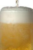 Taza con la cerveza Foto de archivo libre de regalías