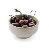 Taza con las cerezas Imagen de archivo libre de regalías