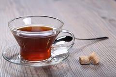 Taza con té y azúcar Imagen de archivo
