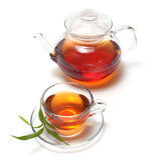 Taza con té y la tetera Foto de archivo