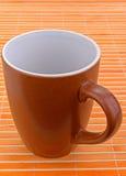 Taza de Brown Foto de archivo