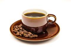 Taza de Brown de café Fotos de archivo libres de regalías