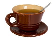 Taza de Brown de té Imagenes de archivo