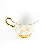 Taza de café adornada de oro de la porcelana Imagenes de archivo