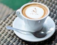 Taza de café caliente en el vector Imagen de archivo