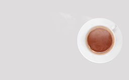 Taza de café caliente en el vector Fotos de archivo