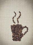 Taza de café caliente Menú decorativo del fondo en la cafetería Fotografía de archivo libre de regalías