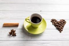 Taza de café con cinamomo Foto de archivo