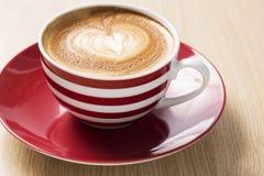 Taza de café con el auge Fotos de archivo