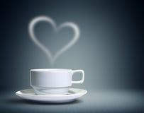 Taza de café con en forma de corazón Fotos de archivo libres de regalías
