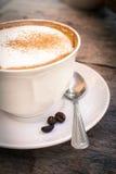 Taza de café con las habas, aún vida Foto de archivo
