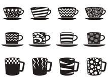 Taza de café con los iconos de los modelos fijados Fotos de archivo