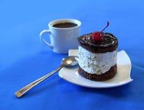 Taza de café con los pasteles Fotografía de archivo