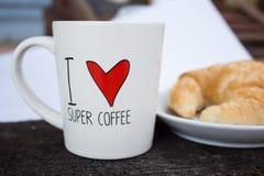 Taza de café con pan Fotos de archivo