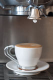 Taza de café con una campana Foto de archivo
