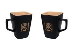 Taza de café cuadrada a la izquierda e a la derecha aislada Foto de archivo libre de regalías