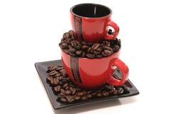 Taza de café de dos rojos Imágenes de archivo libres de regalías