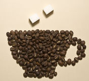 Taza de café de los granos de café Foto de archivo libre de regalías