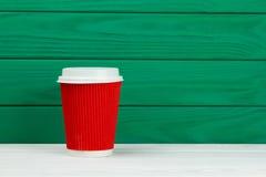 Taza de café de papel roja del café express de la cartulina Foto de archivo libre de regalías