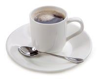 Taza de café en el fondo blanco Imagenes de archivo