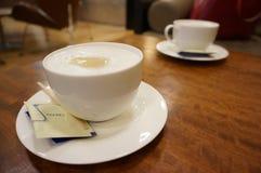 Taza de café en el vector Foto de archivo libre de regalías