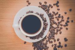Taza de café en estilo del vintage Fotografía de archivo