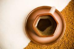 Taza de café en los argumentos de café foto de archivo libre de regalías