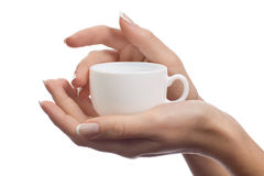 Taza de café en manos femeninas Imagen de archivo