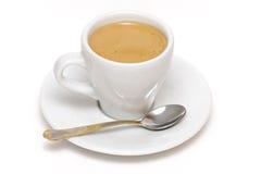 Taza de café express con la cuchara Fotografía de archivo libre de regalías