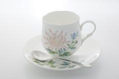 Taza de café floral. Foto de archivo libre de regalías