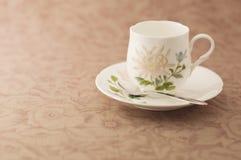 Taza de café floral. Fotos de archivo libres de regalías