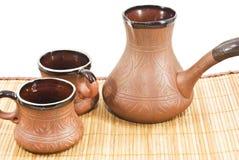 taza de café llenada y fabricante de café Fotografía de archivo libre de regalías
