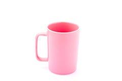 Taza de café rosada foto de archivo