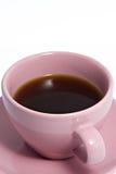 Taza de café rosada por completo de café Foto de archivo libre de regalías