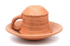 Taza de café vacía en una placa Imagen de archivo libre de regalías