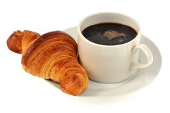 Taza de café y de cruasán fotografía de archivo
