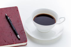Taza de café y cuaderno del rojo del grunge Fotografía de archivo libre de regalías