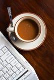Taza de café y de cuaderno Imágenes de archivo libres de regalías