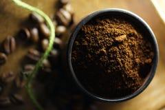 Taza de café y de granos de café Imagen de archivo